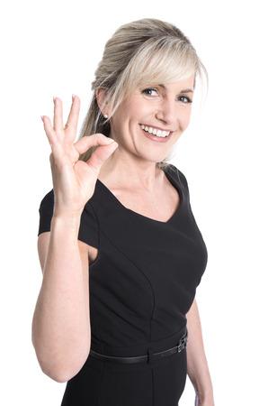 Foto de Charming older business woman making excellent symbol with her fingers. - Imagen libre de derechos