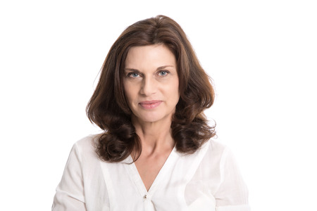 Isolated serious and doubtful mature woman in middle age.