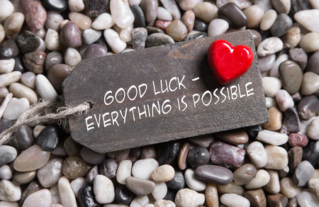 Good luck and everything is possible: greeting card with red heart for courage and recovery.