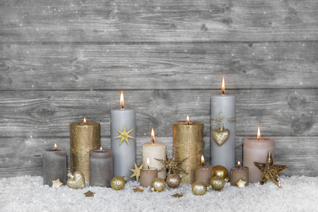 Merry christmas greeting card: wooden grey shabby background with candles.