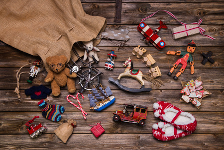 Christmas memories in childhood  old used and tin toys on wooden background for gifts