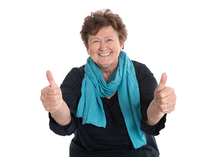 Enthusiastic and happy funny grandmother making thumbs up gesture with two fingers.