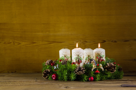 Natural advent wreath or crown with two burning white candles