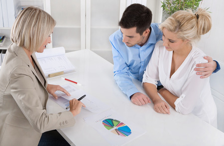 Young couple have an appointment with a banker or adviser for retirement arrangements.