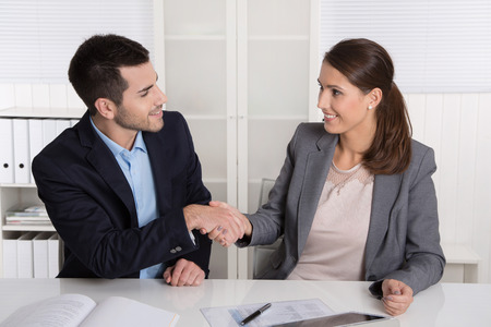 Business talk with handshake: counselor and customer or hello to a new colleague.