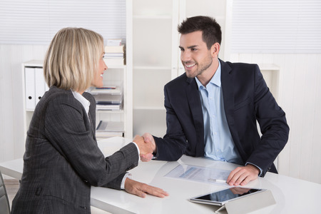 Photo for Successful business meeting with handshake: customer and client shaking hands in the office. - Royalty Free Image