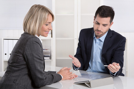 Photo pour Successful business team or costumer and client in a meeting or discussion. - image libre de droit