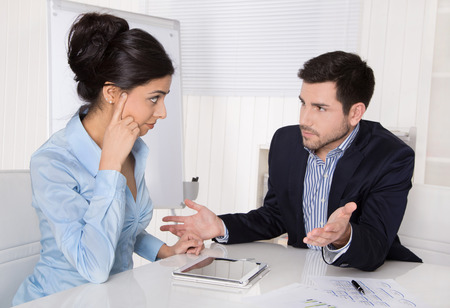 Conflict and problems on workplace: discussing boss and trainee in a meeting.