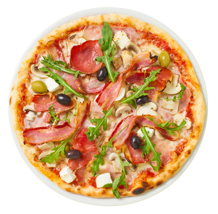 Overhead shot of tasty pizza with plenty of fresh toppings