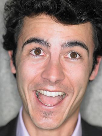 Foto de Close up portrait of young man smiling - Imagen libre de derechos