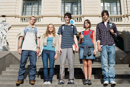 Photo for Teenagers standing on college steps - Royalty Free Image