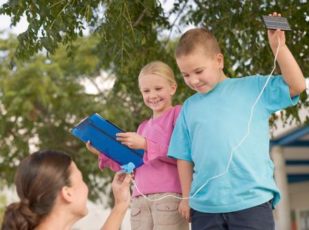 Photo for Children holding solar panels - Royalty Free Image