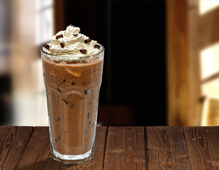 Photo for Iced coffee mocha with whipped cream on wooden table at cafe - Royalty Free Image