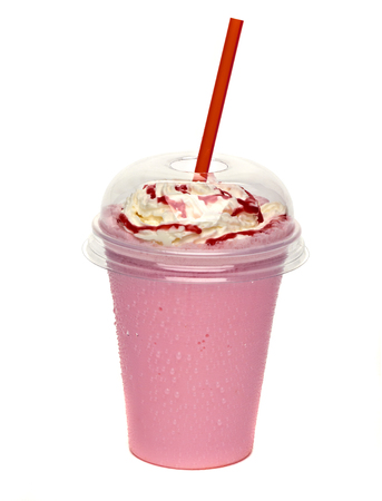 Strawberry milkshake with cream and sauce in take away cup