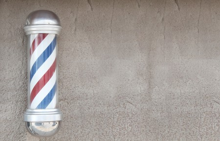 Barber's pole with wall space for background