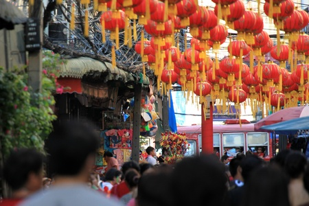 BANGKOK - JANUARY 23 : Chinese New Year 2012 - People walking through the busy streets in Chinatown, Bangkok, Thailand