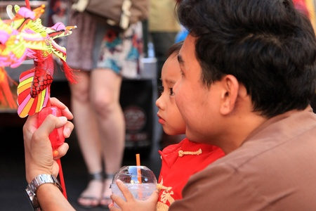 BANGKOK - JANUARY 23 : Chinese New Year 2012 - Celebrations in Chinatown, Bangkok, Thailand