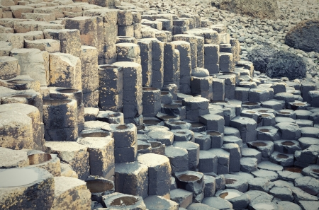 Massive black basalt columns of Giants Causeway in  Northern Ireland