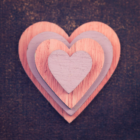 Wooden colorful hearts inside of each other