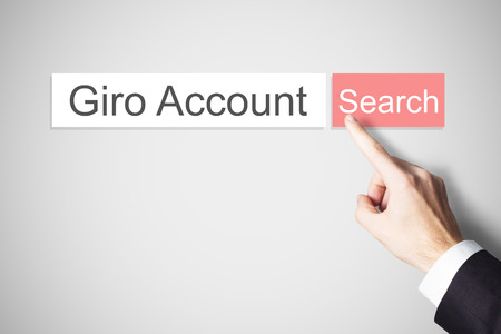 businessmans finger pushing red webbrowser search button giro account