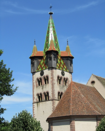 The lovely church of St George in Chatenois, in the wine region of Alsace, France  Built between 1759 and 1761 the tower has a striking green decoration which is highly visible across the landscape