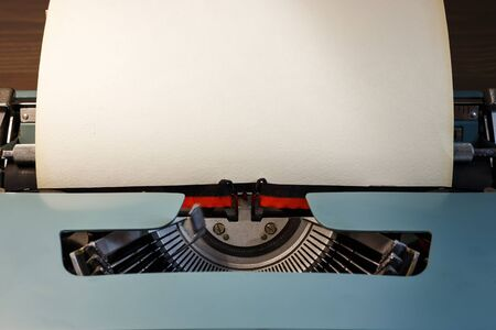 Photo pour Vintage typewriter with blank paper. Space for text. The concept on literature, historical, education. - image libre de droit
