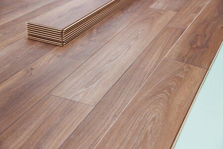 Photo for Installing wooden laminate flooring with soundproofing sheets laying - Royalty Free Image