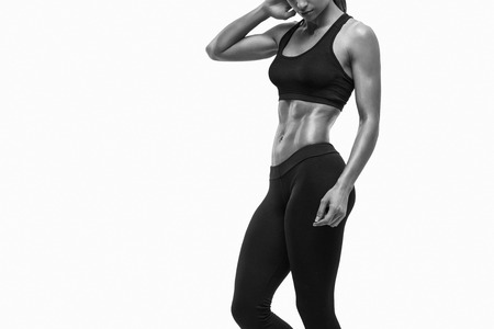 Photo for Fitness sporty woman showing her well trained body. Strong abs showing. - Royalty Free Image