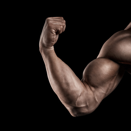 Foto de Closeup of a power fitness man39s hand. Strong and handsome young man with muscles and biceps. Studio shooting on black background. - Imagen libre de derechos