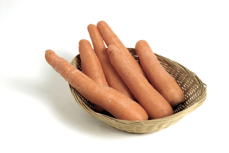 several carrots in a wicker basket