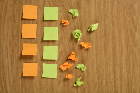 Crumpled and normal paper notes with a smooth, color orange and green