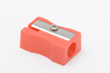 Red sharpener on white background