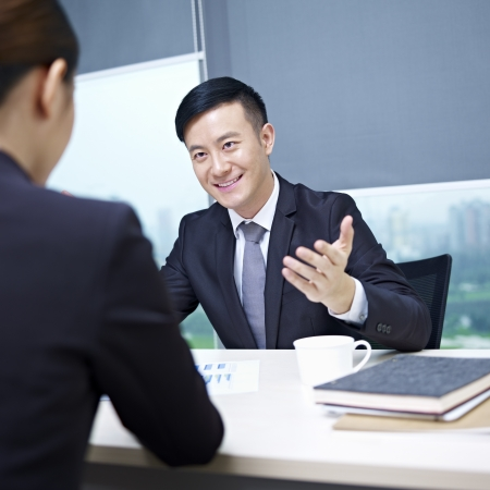 asian business executives having a discussion in office の写真素材