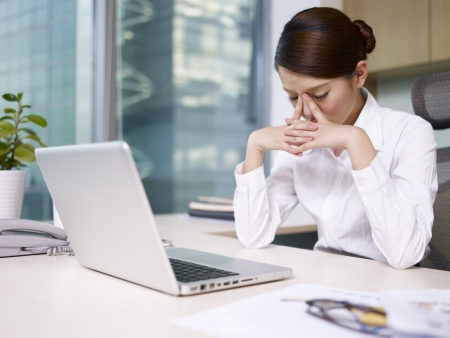 Photo pour asian businesswoman sitting and thinking in office, looking tired  - image libre de droit