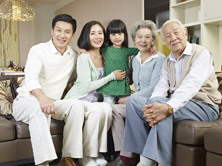 Foto de home portrait of a three-generation asian family - Imagen libre de derechos