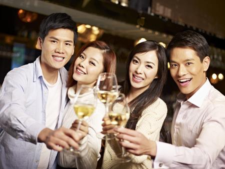 Photo pour young asian friends couples enjoying party in pub  - image libre de droit