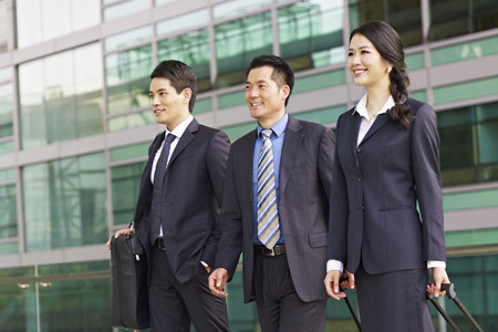 team of asian business people with modern building background.の写真素材