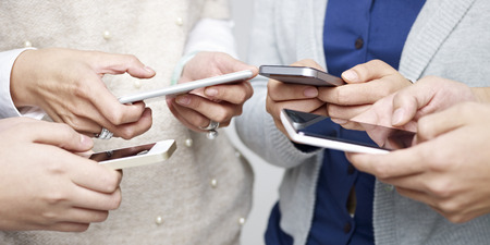Photo for small group of people using cellphones together. - Royalty Free Image
