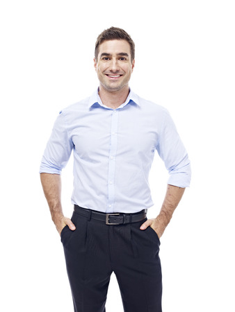 studio portrait of a caucasian corporate executive, hands in pockets, isolated on white background.