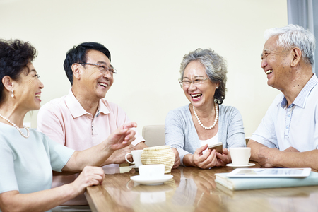 Photo pour small group of senior asian people getting together talking and laughing - image libre de droit