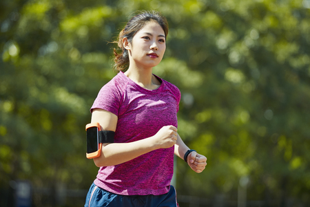 Photo for young asian woman track and field athlete running - Royalty Free Image