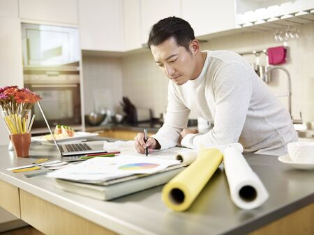 Photo for young asian designer working from home drawing on drafting paper - Royalty Free Image