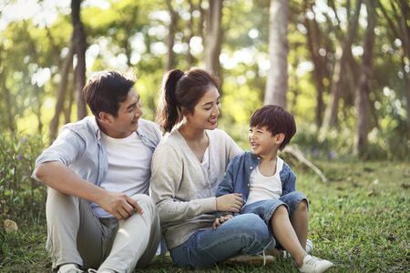 Photo for young asian parents and son having fun outdoors in park - Royalty Free Image