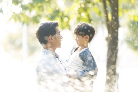Photo for asian father and son enjoying good time outdoors in park - Royalty Free Image