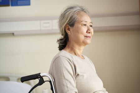 Photo for Asian senior woman sitting in wheelchair in nursing home - Royalty Free Image