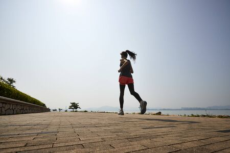 Photo for young asian adult woman running jogging outdoors - Royalty Free Image