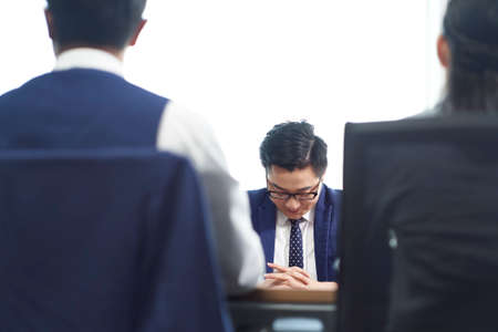 Photo pour young asian business man looking sad after learning termination of employment - image libre de droit