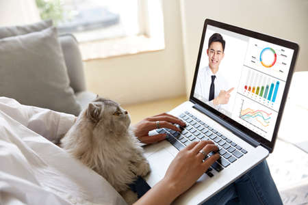 Photo for young asian corporate executive participating an online business presentation via video conference using laptop computer - Royalty Free Image