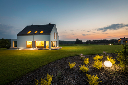 Photo for Photo of modern house with outdoor lighting, at night, external view - Royalty Free Image