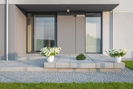 Foto de Grey villa with new design entrance, lawn, glass doors and decorative plants - Imagen libre de derechos